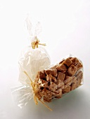 Brown and White Sugar Cubes in a Cellophane Bags