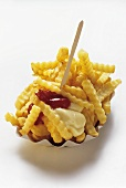 Crinkle Cut French Fries in a Carton with Ketchup and Mayonnaise