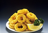 Onion Rings on a Plate with Lemon Wedge and Parsley