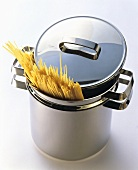 Uncooked Spaghetti in a Stainless Steel Pot