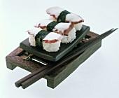 Three Maki Tako Sushi on a Japanese Box