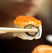 One Reverse California Roll on Chopsticks