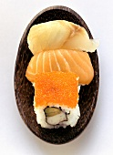 Assorted sushi in wooden bowl