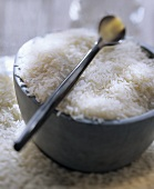 Uncooked Jasmine Rice in a Bowl with a Spoon