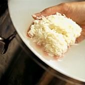A Handful of Rice Being Rinsed