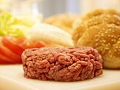A Hamburger Patty with Bun and Vegetables