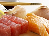 An Assortment of Sushi with Tuna and Salmon on Wooden Block