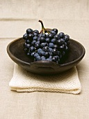 Purple Grapes in a Bowl Resting on a Towel