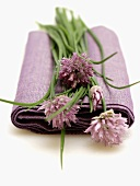 Flowering Chives Resting on a Lilac Napkin