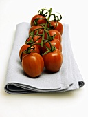 Vine Ripened Plum Tomatoes Resting on a Cloth