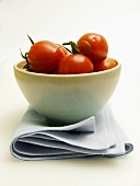 Bowl of Tomatoes Resting on a Cloth