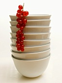 Stacked White Bowls with Red Currants