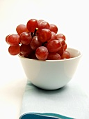 Bunch of Red Grapes in a White Bowl