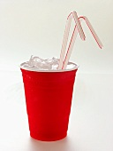 Red Plastic Cup with Ice and Straws