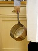 Holding a Copper Pot