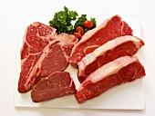 Beef steaks on chopping board