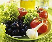 Salad ingredients: tomatoes, garlic, olives & Lollo Biondo