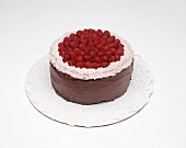 Chocolate cake with raspberries on doily