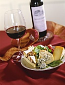 Cheese Plate with Glass and Bottle of Red Wine