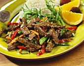 Stir Fried Beef and Vegetables on a Plate with Rice