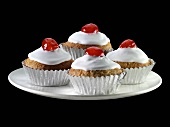 Cupcakes with cocktail cherries