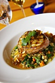 Prosciutto Wrapped Swordfish over Spinach and Lentil Salad