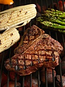Porterhouse Steak on the Grill with Corn and Asparagus