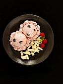 Black Cherry Ice Cream with White Chocolate Shavings and Raspberries