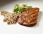 Grilled Steak with Wild Rice and Salad on White