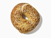A sesame and poppy seed bagel with salt, seen from above