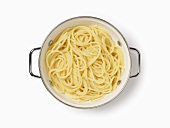 Cooked spaghetti in a colander, seen from above