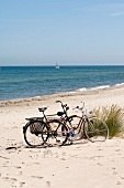 Two bicycles on a sandy beach