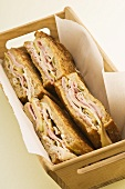 Ham sandwiches in a wooden box