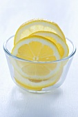 Lemon slices in a glass bowl