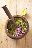Guacamole with onions in a mortar