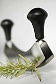 A chopping knife and rosemary