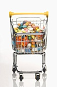 A shopping trolley filled with vitamin tablets