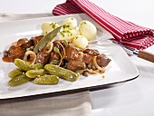 Westphalian Pfefferpotthast (braised beef with vegetables) with salted potatoes and gherkins