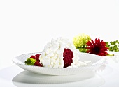 Raspberry snow ball (raspberry sorbet topped with cream and meringue)