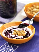 Yogurt with blueberry jam and cereals