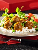 Meatballs with curry sauce on a bed of rice