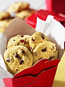 Orange and cranberry cookies in a take-away box