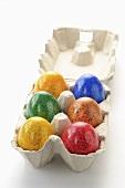 A box of six coloured eggs
