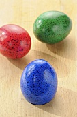 Three coloured eggs