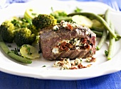 Stuffed beef medallions with feta and dried tomatoes