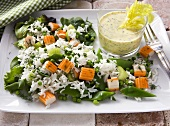 Rice salad with surimi, mange tout and a yogurt dip