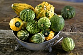 Ornamental pumpkins in a tin bowl