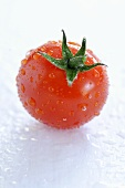 A freshly washed cherry tomato