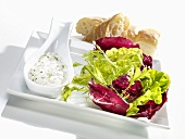 A mixed leaf salad with a creamy goats' cheese dressing