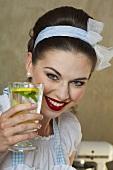 A retro-style girl holding a glass of lemonade